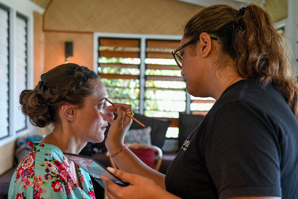 Closeup of the bride's eyebrows being done by Kajal of Totoka Hair and Makeup