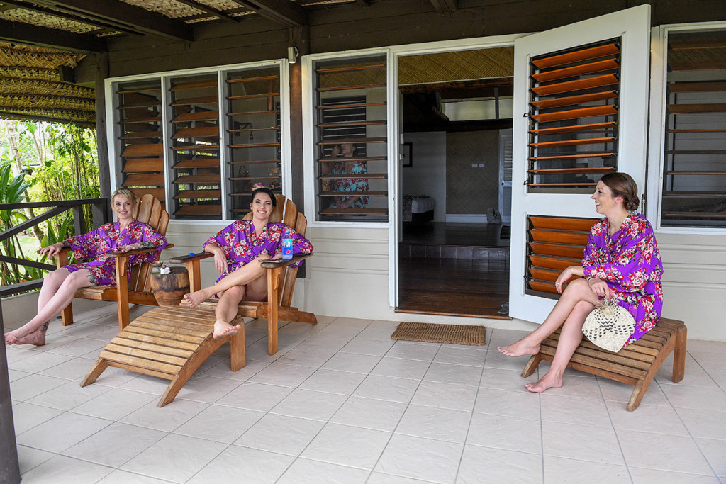 Bridesmaids lounge on the front porch at the Musket Cove suits