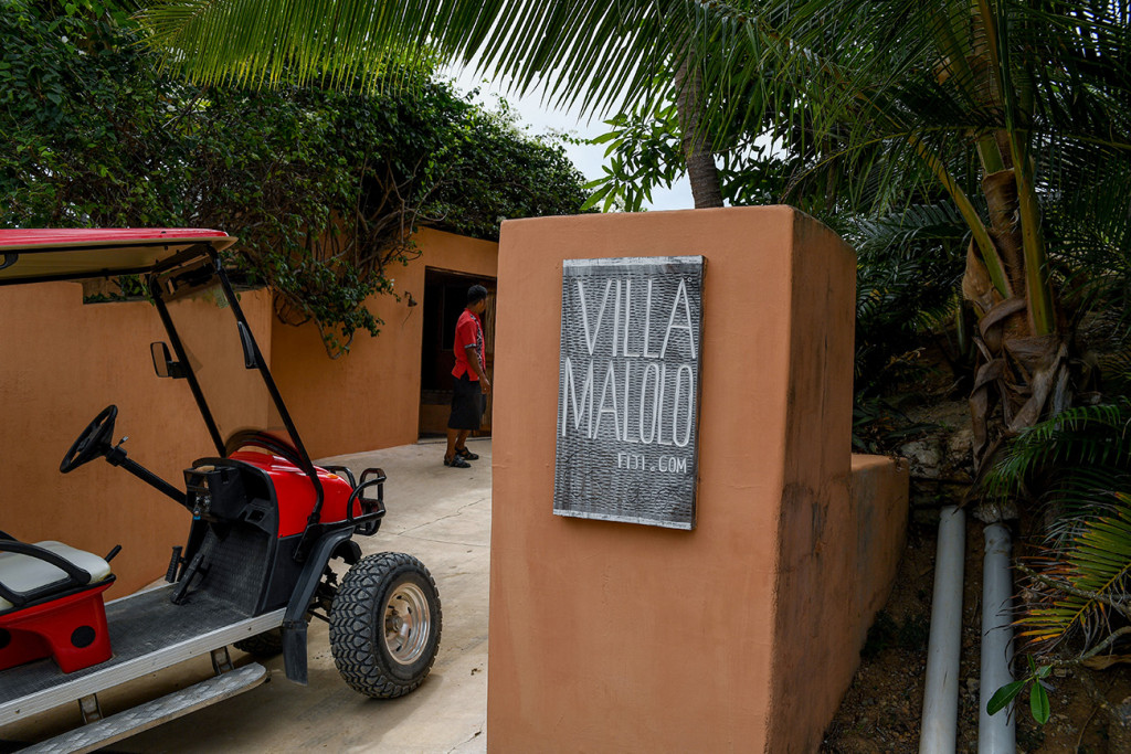 Red golf cart parked at the door of the Villa Maloo entrance