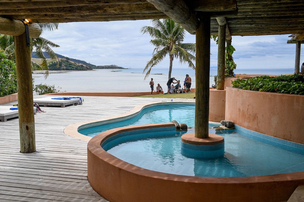 Curved infinity pool at the edge of the sea at the Musket cove island resort, Fiji
