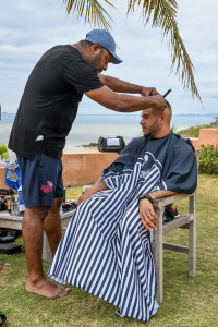 Groomsmen being shaved seaside