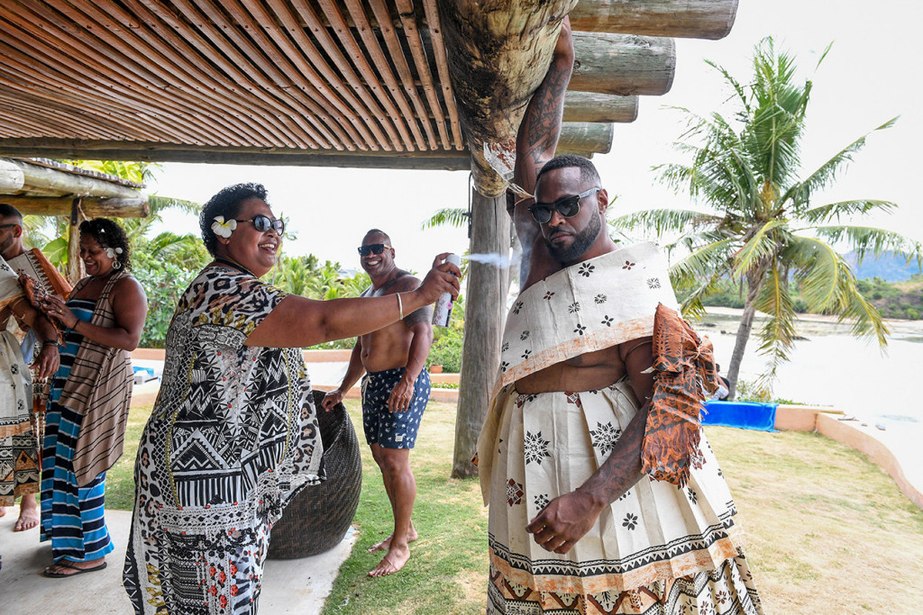 The groom's Fiji aunty sprays deodorant on him