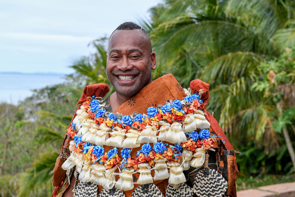 A super happy groom poses in traditional Fiji masi ready for his wedding