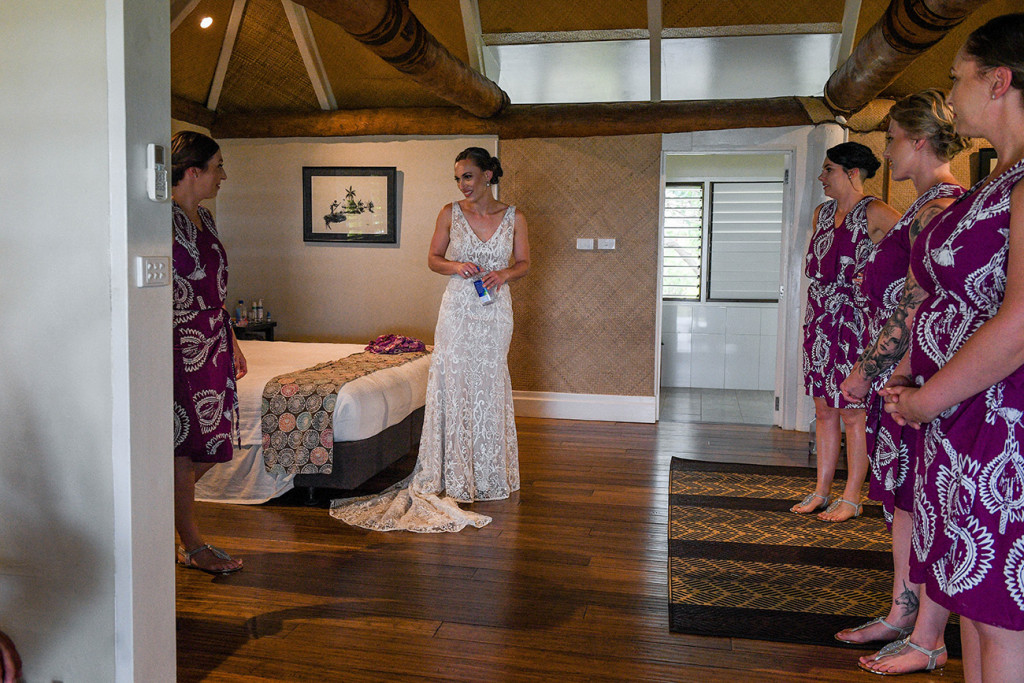 The bridesmaids admire the gorgeous bride