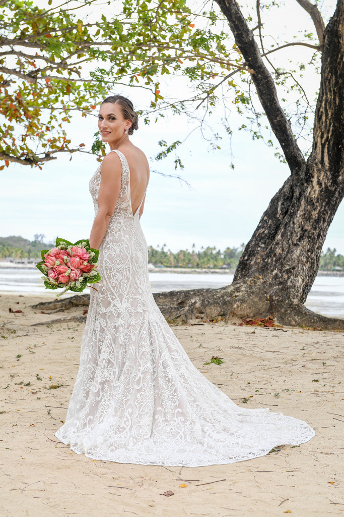 The stunning bride poses on the shores of the beach at Musket Cove