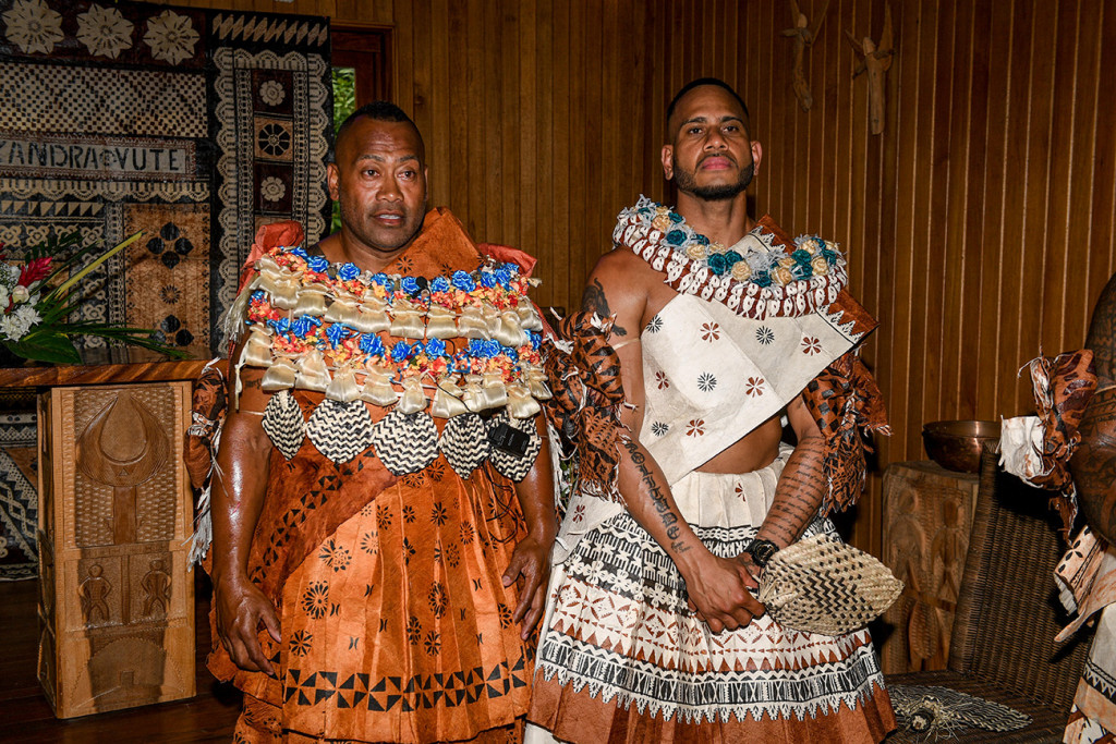 A traditional clad Fiji groom waits with his best man at the altar