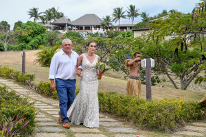 Bride walks aisle with father