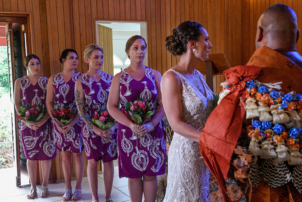 The bridesmaids lineup watch as the bride and groom exchange vows