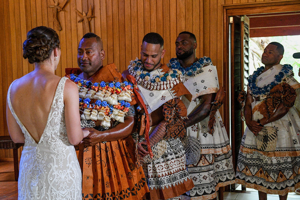 Groomsmen watch as the bride says her vows