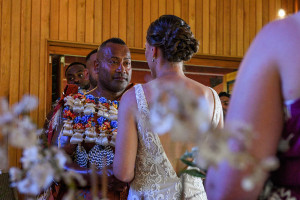 Groom watches wife say vows