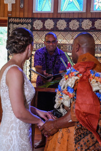 The celebrant gives rings