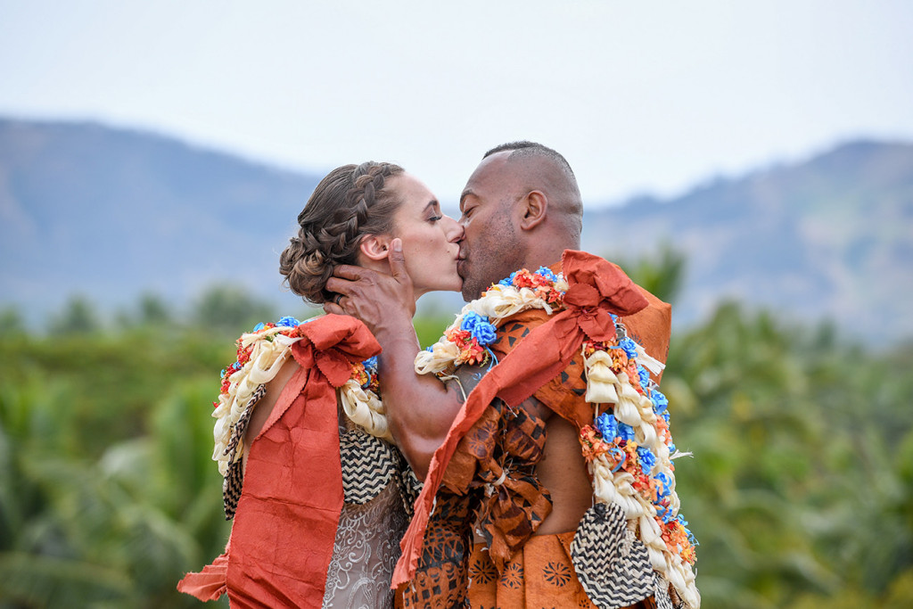 The Fiji groom passionately kisses his bride at Musket Cove