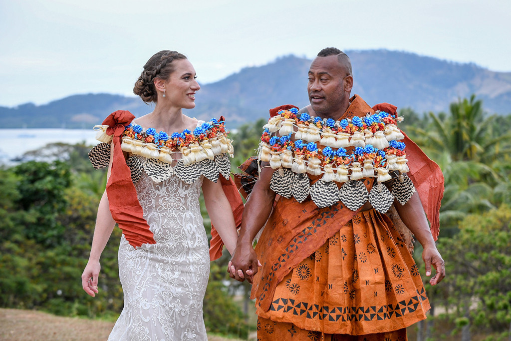Newly Married Fiji couple walk hand in hand against the breathtaking Fiji landscape