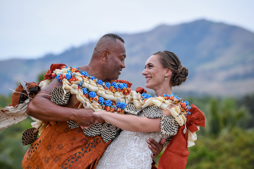 The newly married couple dance against the breathtaking landscape of Fiji