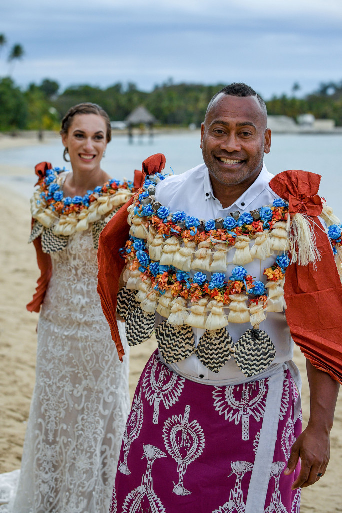 The stellar groom leads his bride on the shores of the Pacific