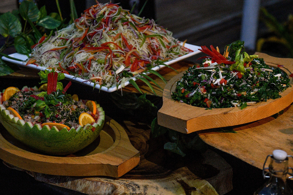 Colourful salads served in natural watermelon and wooden salad bowls