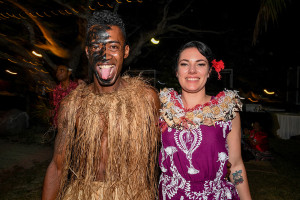 Fiji performer poses with bridesmaid