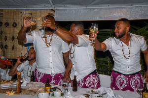 Groom and groomsmen raise toast