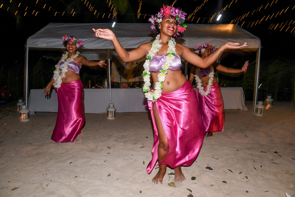 Entertainers perform dances with flower wreaths and traditional dance