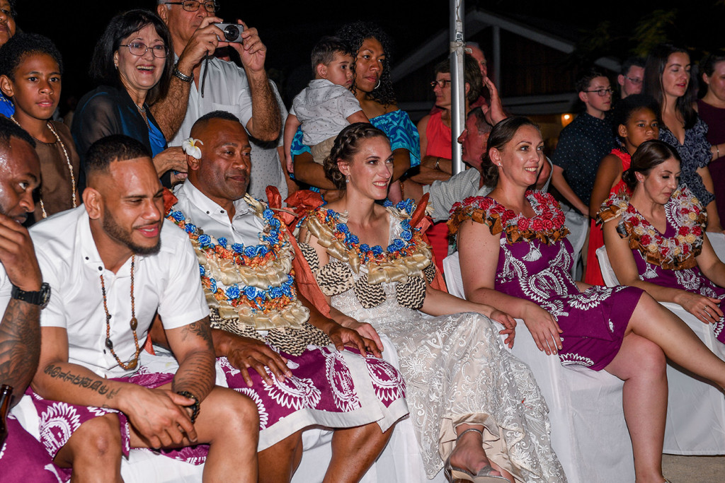 The newly married couple and their wedding guests watch the performances in awe