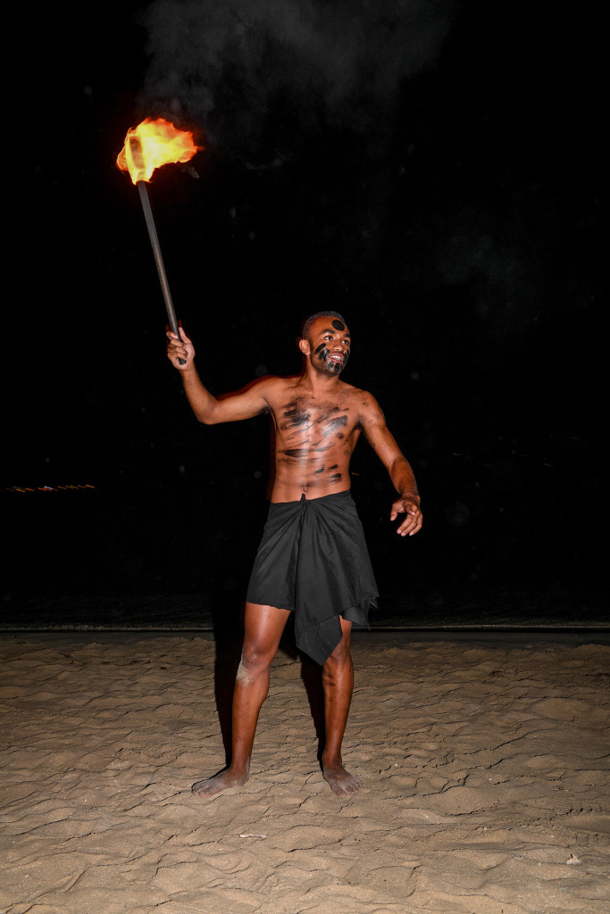 A Fiji performer starts up the fire display
