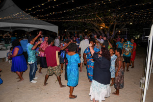 Wedding guests join dance