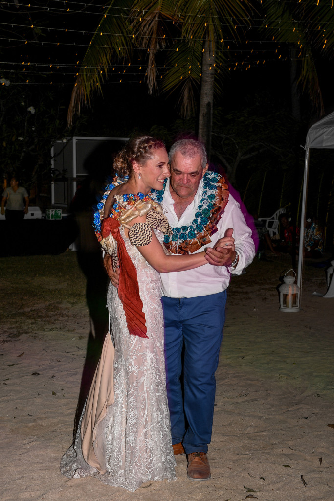 Father and daughter share the first dance on the beach at Musket Cove