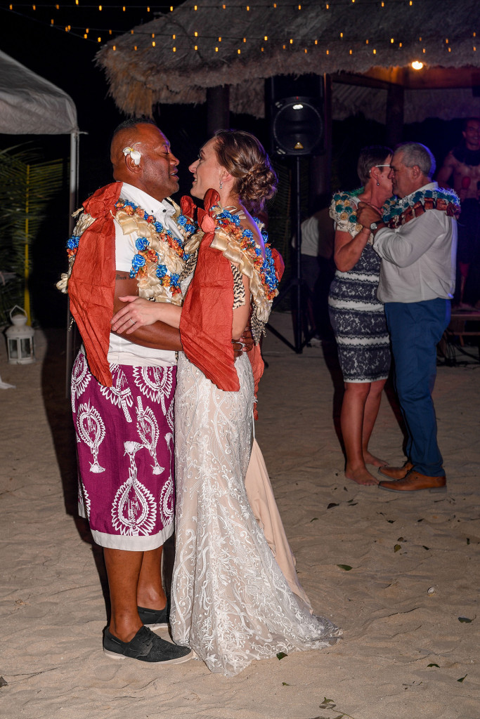 The bride and groom share their first dance on the beach at Musket Cove
