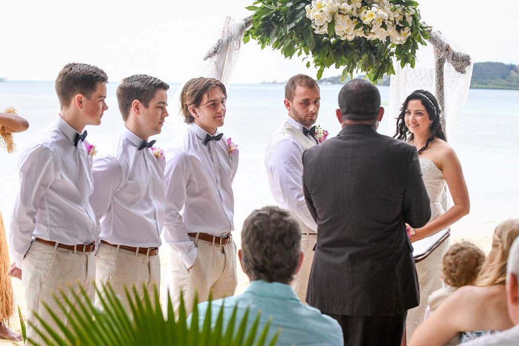 The groomsmen watch as the celebrant officiates the wedding ceremony