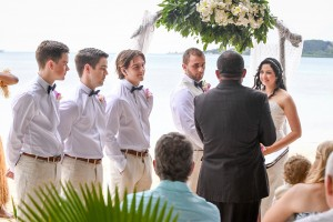 Groomsmen watching celebrant