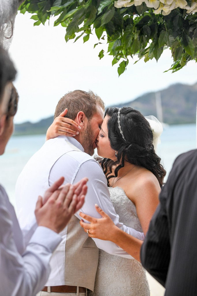 The newly-weds share a first passionate kiss as man and wife