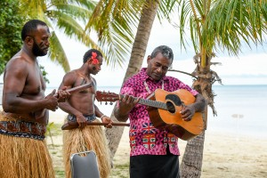 A Fiji guitarist strums the guitar at the wedding ceremony