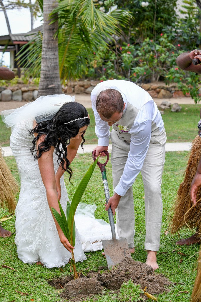 The couple plant a tree to commemorate their union