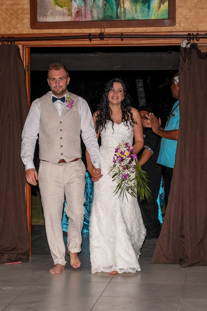 The newly weds arrive barefoot at their reception venue at Plantation Island Resort