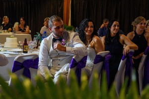 The newly weds watch a speech being given