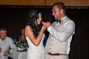 The groom feeds the bride a piece of the cake