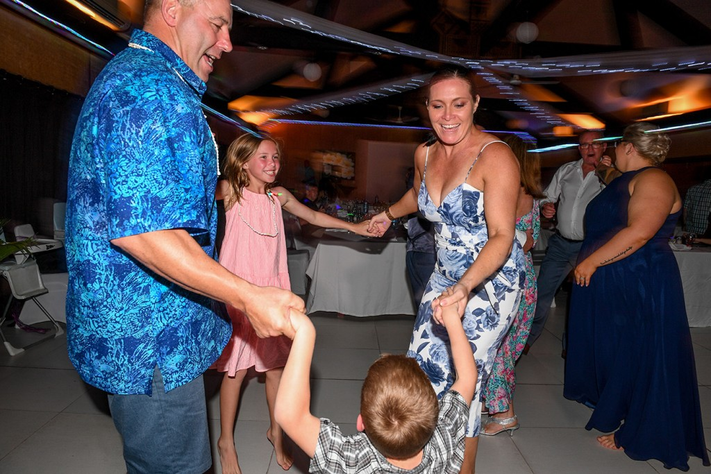A family have a good time dancing at the wedding