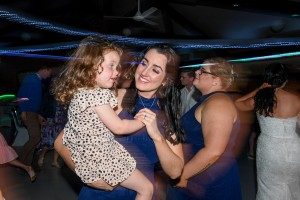 A mother dances with her daughter on the dance floor
