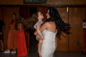 Bride and flowergirl dance