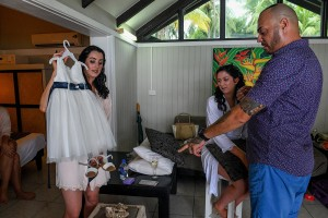 The bride admires the flower girl's dress