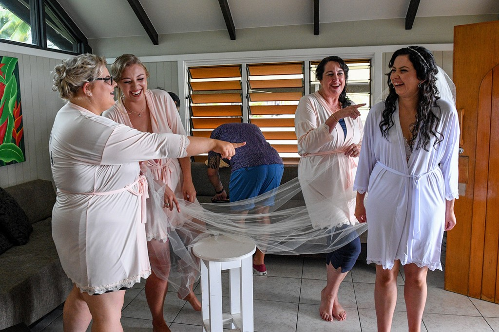 The bridal team goofs around with the bride