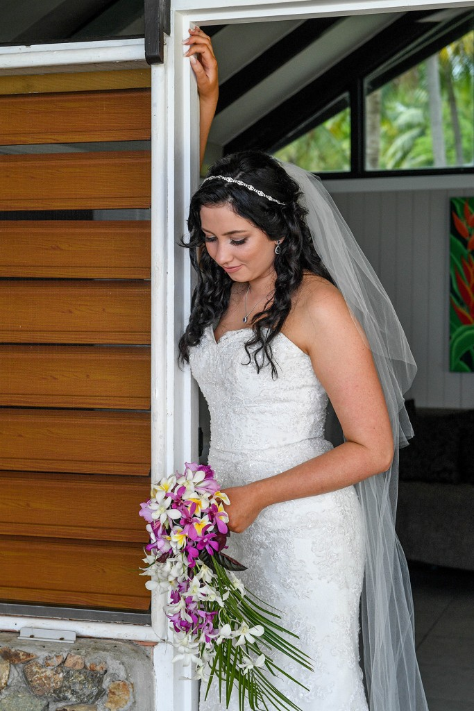 The stunning bride stands at the doorway