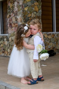 The flower girl hugs the page boy