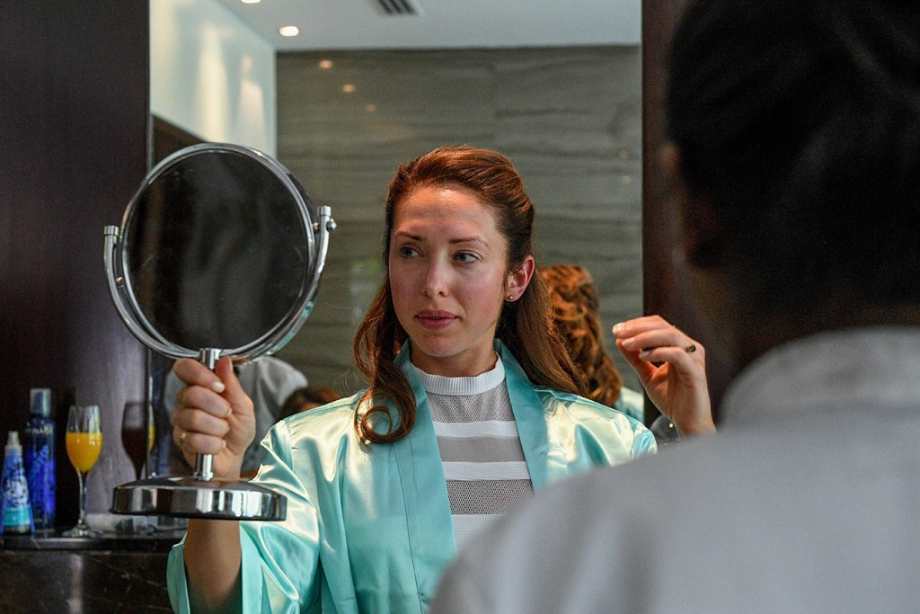 A bridesmaid admires her reflection