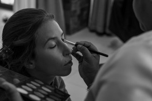 A monochrome picture of the bride having her makeup done