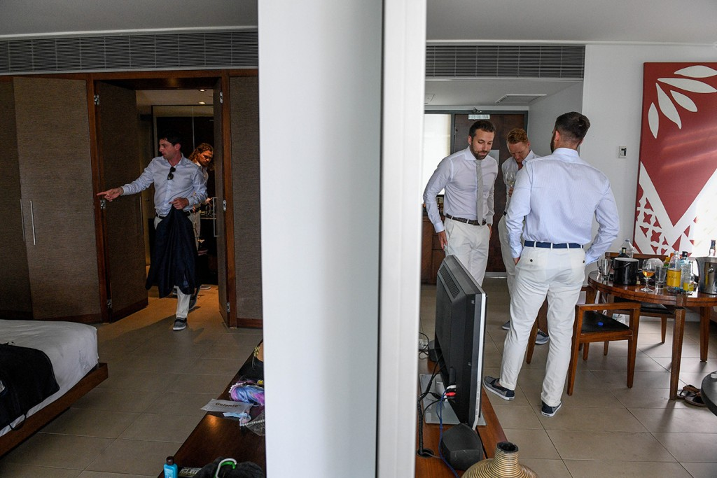 The groomsmen get ready in the different rooms in the room