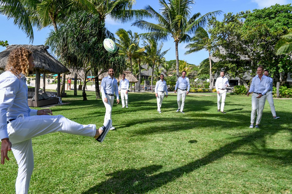 The groomsmen play a light game of rugby before the ceremony