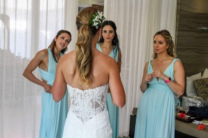 The bride shows her bridesmaids her look one last time