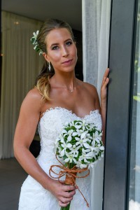 The stunning bride poses at the doorway