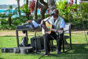 A guitarist from Rue Fiji entertains the guests